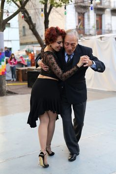 The man in the photo is 82 years old. He was encouraging everyone in the square to come and dance the Tango//