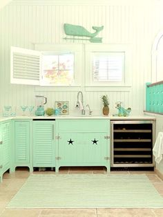 Mint Cabinets & Kitchen ...love the star cutouts instead of knobs