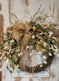 Handmade item Materials: grapevine wreath, glue, wire, wired burlap, realistic fern, realistic greenery Made to order Ships from United States Questions? Contact shop owner Item details This beautiful Fall front door wreath is the perfect simple accent for your door or interior. A wired burlap ribbon makes a simple bow. FRONT DOOR WREATH Average Diameter: 22 (tip to tip) This wreath will be created on a grapevine wreath measuring approximately 18 Indoor/ Sheltered Outdoor Safe **a...