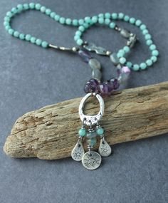 Amazonite, amethyst, gray moonstone, labradorite, and purple florite play pretty together in this free-spirited necklace with Luna's Original Fine silver flower