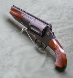 "MTs-255 revolver shotgun was developed during early 2000s by Central Research and Design Bureau of Sporting and Hunting arms (TSKIB SOO), located in the city of Tula, Russia. Originally produced as a hunting / sporting gun in a number of calibers (12, 20 and .410 gauges) and configurations, it was also offered as a ""tactical"" weapon for Law Enforcement use, in 12 gauge and equipped with side-folding stock. Weapons Guns, Guns And Ammo, Cool Guns, Shotguns, Revolvers, Firearms, Tactical Revolver, Tactical Shotgun, Tactical Gear"