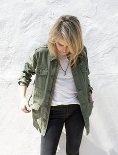 Mother Denim military-inspired jacket, IRO white tee with neck hole, Mother Denim faded black skinny jean, Paula Rosen horn chain necklace