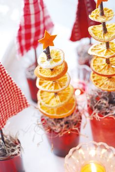 diy christmas gifts two christmas tree ornaments made from dried orange slices spiked on a twig with little orange cut out star on top near other decorations small candle Noel Christmas, All Things Christmas, Winter Christmas, Christmas Tree Decorations, Christmas Tree Ornaments, Christmas Cupcakes, Deco Table Noel, Dried Orange Slices, Navidad Diy