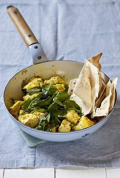 Scrambled curried tofu with spinach and peas.