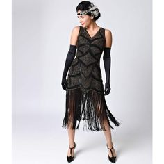 Iconic by UV Black & Antique Gold Beaded Mesh Isadora Fringe Flapper... (£215) ❤ liked on Polyvore featuring dresses, black, fringe dress, vintage sequin dress, vintage style flapper dresses, vintage dresses and beaded cocktail dresses