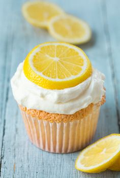 Lemon Angel Food Cupcakes - so light and delicious! I wanted to eat the topping for these by the spoonful it tastes like lemon cheesecake!