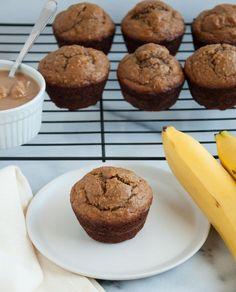 These peanut butter banana muffins are absolutely delicious, perfectly moist, and loaded with heart healthy oat flour and over 8 grams of protein. Yum!  - Feasting Not Fasting