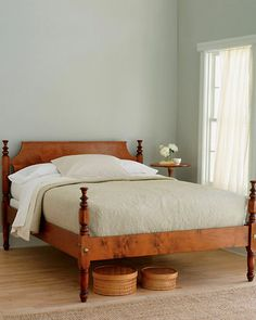 """An old-fashioned bed with hand-turned posts and classic tulip finials. Due to its highly detailed, hand-finished construction, please allow 8 to 10 weeks for delivery. Solid mortise-and-tenon joinery. Angle iron supports. Maple. Assembly required.Size: 45"""" H headboard, 34"""" H foot post, 7"""" W rails    Item: 6026 - Tulip Bed  $1,598.00 - 3,698.00"""