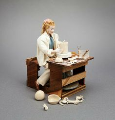 Craig Roberts: Hand-turned Pottery [in miniature] & More: Female potter working on a potter's wheel.