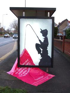 """Brilliant. 12thoctave: """" Street art from Eyesaw using a bus stop ad-shell to feature a cheeky Peter Pan-esque cut out fishing for a T-Mobile advert. See more of Eyesaw's stuff on Flickr"""""""