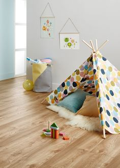 Godfrey Hirst's Amor Laminate flooring in colour Macro Oak Nature as seen here in this gorgeous play room. Amor has an 'embossed in register' grain which authentically replicates the appearance and texture of timber.