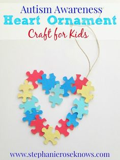 Autism Awareness Heart Ornament Tap the link to check out fidgets and sensory toys! Happy Hands Toys!