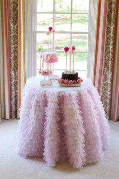 pink party: love the ruffle tablecloth + extra tall cake skewers with pom pom flowers