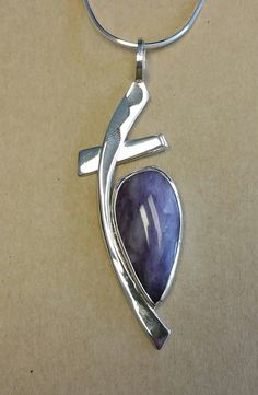 Modern cross with Russian Charoite! Check out this item in my Etsy shop https://www.etsy.com/listing/247395027/russian-charoite-hand-cut-stone