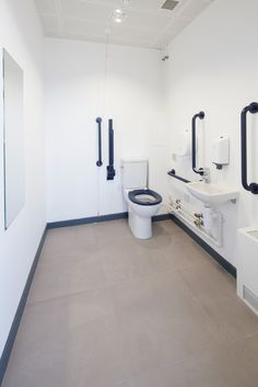 modern toilet wc design at a commercial office. tiles from solus