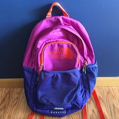 North face backpack Used but still in great shape. Super roomy with lots of compartments and space. Couple pen markings on the front but hardly noticeable. Straps are very sturdy and durable. Has a waist band thing if you want to carry this while hiking. Blue, purple and orange. Great backpack for a great price! ✨ North Face Bags Backpacks