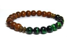 Green with wood mens bracelet made with 8mm Green Tiger Eye and 8/9mm Robles Wood. Earthy and strong. Tiger Eye Properties: Helps to keep you focused, centered and grounded. It is also beneficial for