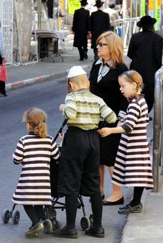 An Orthodox Jewish mother takes her children for a walk in Mea Shearim, which is mainly populated by Haredi Jews and is onemore...