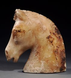 ALEXANDRIAN ALABASTER HORSE HEAD -     Possibly a game piece.  Very fine style.    Egypt, 1st Century BC/AD    H. 5 1/8 in. (13 cm.)    Ex L. B. collection, New York.    Published: J. Eisenberg, Art of the Ancient World, II, 1967, no. 66.