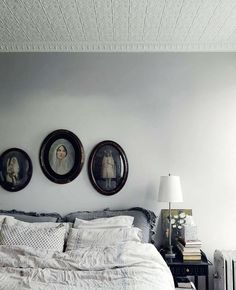 high ceilings, tin ceiling tiles, convex picture frames...