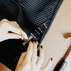 Chloe attaching custom chain links to pant pockets