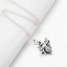 Bees are vital to our food supply and existence. Show everybody your love for bees by wearing this cute honeybee necklace! - 925 sterling silver charm and chain - Charm size inch x inch -Chain length 18 inches Bee Necklace, Necklace Types, Bee Jewelry, Fashion Necklace, Sterling Silver Jewelry, Silver Earrings, Friends, Necklaces, Honey Bees