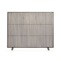 A fire screen like this one adds texture and a modern touch to the space, and provides a simple cover to your fireplace. Discover much more on Anne Tollett Home.