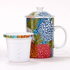 Your favorite loose teas stay flavorful and hot in this pretty porcelain Chrysanthemum Infuser Mug. While your teas are brewing, you'll enjoy the exclusive floral design in bright colors. Set includes a mug, porcelain filter and lid, all dishwasher safe.