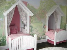 "Alcoves built for twin beds.  Bookcases were built inside each alcove.  The wall is a hand-painted mural depicting a wooded landscape with clouds.  A cute, clever idea to have a little ""hideout"" alcove that is made into a cottage look. designdazzle.blog...  #child #girls #bed #room #bedroom #canopy #alcove #mural #faux #hand-painted #decor #idea"