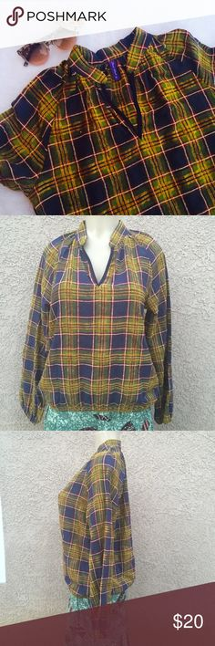 """Plaid Shirt Plaid shirt in 100% cotton with elastic at sleeves hem and the shirt hem . Bust measures :20"""" length 25"""". Tops Tees - Long Sleeve"""