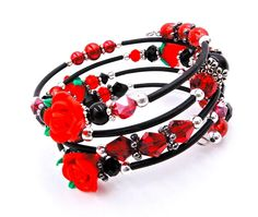 This elegant memory wire wrap bracelet is made with an assortment of glass beads, Swarovski crystals, glass pearls, silver spacer beads, silver bead caps, rubber tubing, and red rose polymer clay beads and will wrap around the average wrist about 4 times. ★ Return to my main shop page here for more inventory ★ www.etsy.com/shop/bridgetollbeading ★ Read my FAQs below and if you have any further questions please do not hesitate to contact me! ★ https://www.etsy.com/s...