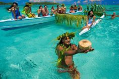 Whenever there is a cause for celebration, the Tahitians decorate their outrigger canoe - join in the fun!