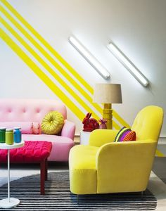 A little modern + a lot colorful, this bold living room is bright in all the right places.