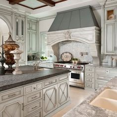 Mediterranean Kitchen by Dallas Design Group, Interiors