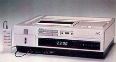 Yep! THAT is our old VCR!!! My dad added an extra long CORD for the remote!!! LOL! I used that thing until 1998 when I was 28 when I finally bought a new one!!! I was 11 when my parents first bought this one! 1981  jvc hr 7200 vhs vcr.