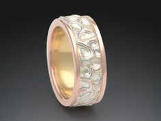 Seamless mokume ring in 18k yellow gold, 14k palladium white gold, 14k rose gold, and sterling silver in the Canyon pattern by James Binnion