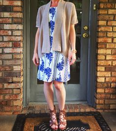 Blue & White Floral Print Dress, Neutral Short-Sleeve Knit Cardigan, Brown Lace-Up Wedges