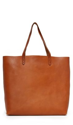 cc5c7e18dfb3 This lovely cognac tote bag is perfect for toting around all of your things  (or your kid s things)!