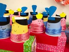 Japanese Hina Dolls. My 4-5 year olds loved this. 2 paper cups, string, milk carton, coloured paper, patience. More photos of this and other crafts in my Tim Sensei Blog via the image link.