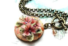"Textile Necklace Fabric Necklace Toggle Necklace by veryDonna...Reminiscent of 1900's perfume buttons... Super Large and Colorful Orange-Pink-Marigold combination is so pretty Lots of yummy textiles and vintage millinery come together to create this very special piece. The 1 5/8"" pendant hangs from an Antique Bronze Chunky Rollo chain with a front toggle clasp closure. ""Statement Necklace""."