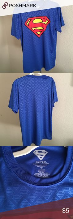 """M/L Superman shirt Worn once. Men's M, but I wore it comfortably, I am usually a women's L/12. Armpit to armpit approx 20"""".  100% polyester, feels like a dry-fit. Shirts Tees - Short Sleeve"""