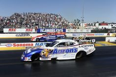 Matt Hagen in the Aaron's Funny Car races Johnny Gray in the Big O Tires Funny Car