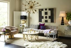 We're loving the tufted accents and gilded pieces in this Jonathan Adler-styled room. Would you decorate your home in a Hollywood regency style?