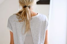 Messy, mussed, low ponytail.
