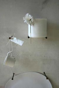 Hang your dinnerware on rusty nails. Even better if it is by Caroline Swift