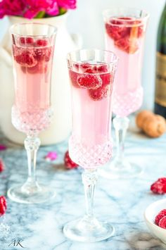 Sparkling Raspberry Lemon Mimosas Recipe - An elegant twist on a classic cocktail. Essential to any celebratory brunch, and great for Valentine's Day!