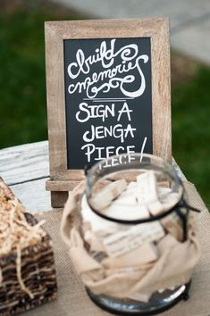 Too cute! Have your guests sign a Jenga piece for a unique guestbook idea! {Daniel Boone Photography}