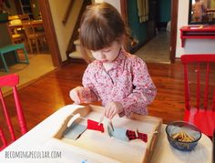 Practicing with a mini-clothesline: Montessori activities for a two-year-old