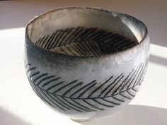 Pinched Porcelain Tea Bowl by Priscilla Mouritzen. Who says porcelain has to be thrown and glazed in a traditional way?