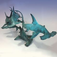 Foundry Cast Bronze #sculpture by #sculptor Nicolas Pain titled: 'Hammerhead Sharks (Bronze swimming Fish Shoal statues/statuettes)'. #NicolasPain